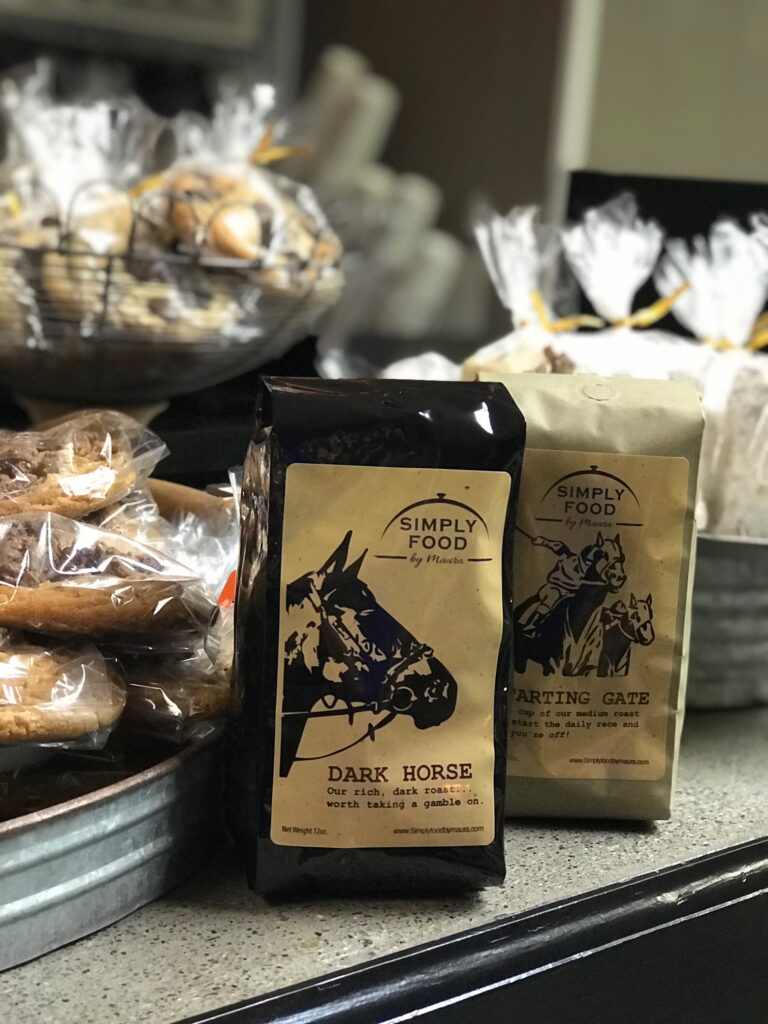 Simply Food by Maura branded Dark Horse and Starting Gate coffee next to fresh baked goods in Saratoga Springs, NY